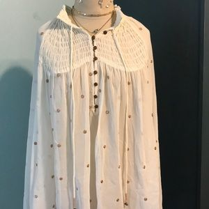 Tops - Free people sheer rose gold polka dot blouse
